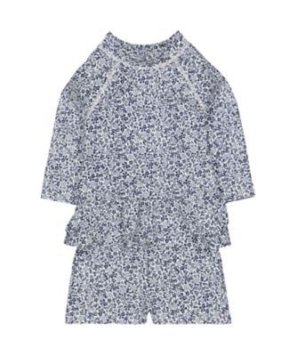floral swim shorts and rash vest