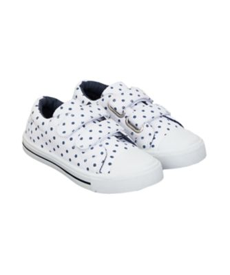 white and navy spot trainers
